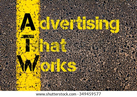 Concept image of Accounting Business Acronym ATW Advertising That Works written over road marking yellow paint line. Zdjęcia stock ©