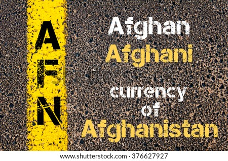 Concept image of Acronym AFN- Afghan Afghani, currency of Afghanistan written over road marking yellow paint line