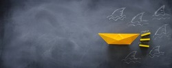 concept image of avoiding crisis. paper boat escaping sharks idea