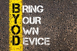 Concept image of Business Acronym BYOD as BRING YOUR OWN DEVICE written over road marking yellow paint line.