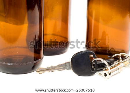 Concept image of drinking and driving with a shot of some car keys beside some empty beer bottles