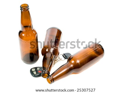 Concept image of drunk driving, with keys and empty beer bottles and the props