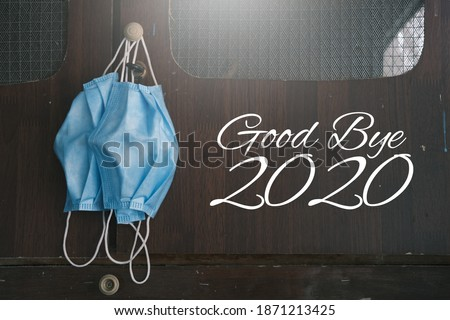 Concept image of end year 2020. Good bye 2020 image with face mask year of pandemic Covid-19