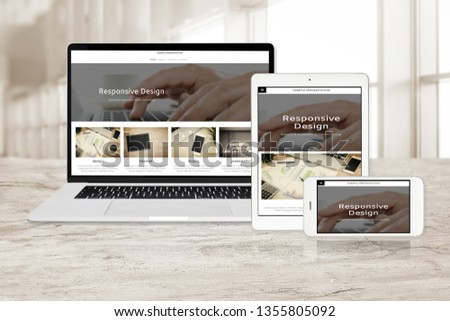 Concept image of multi device technology for responsive web design - laptop , digital tablet and smartphone in various orientation at the office (sample web page). #1355805092