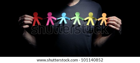 Concept image of people chain cutout paper