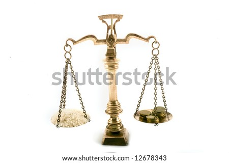 concept image of rice grains and coins on scales to illustrate the value of food