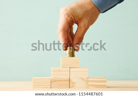 concept image of Saving money or investing. putting stack of coins at the top #1154487601