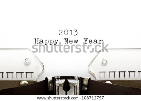 Concept image with 2013 Happy New Year written on an old typewriter