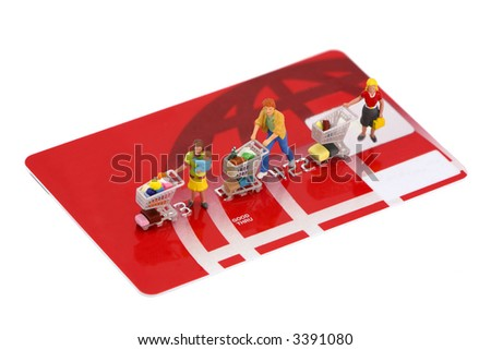 Concept images of shoppers with shopping carts on top of an unbranded credit card. Isolated on white background.