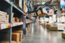 Concept industry 4.0 robotic drone artificial Intelligence,autonomous Robot of warehouse logistic,smart automated delivery vehicle,modern storehouse shipping,with robot carrier carrying cardboard box