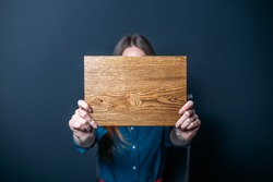 concept inscription on a wooden board in hands.