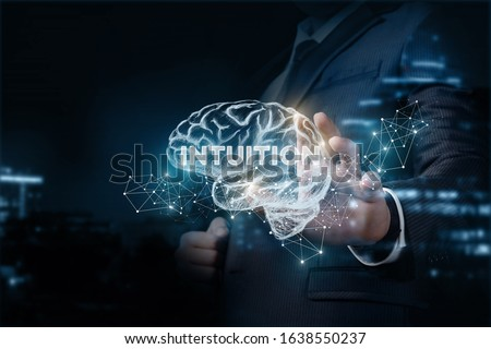 Concept intuition in business. Businessman shows a brain with the inscription Intuition. Stock foto ©