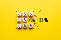 Concept is now hiring. Abstract staff icons on dice
