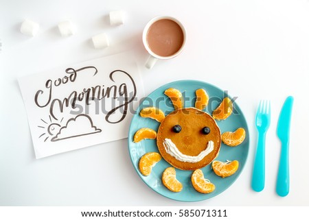 concept kid breakfast with pancake top view on white background