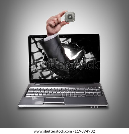 CONCEPT. laptop with broken screen and hand hand holds the processor CPU High resolution
