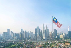 Concept Malaysia Flag with Kuala Lumpur skyline. Merdeka. Malaysia Day.