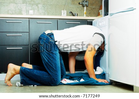 Concept Man Looking inside the washing machine