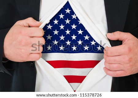 Concept. Man stretches shirt under a print of a U.S. flag. - stock photo