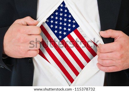Concept. Man stretches shirt under a print of a U.S. flag.
