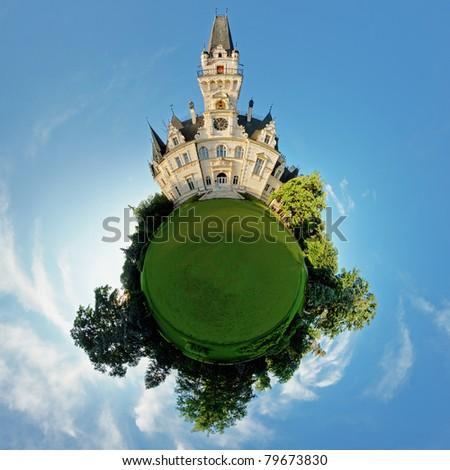 concept miniature globe showing the castle.