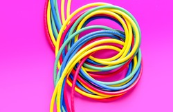 concept network internet cable on pink background close up.