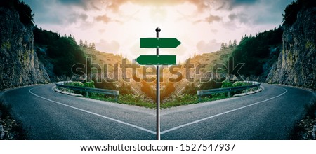 Concept of a blank cross road sign with light behind it. Intended for you to write your own text. Example: Various important choices or to illustrate the decisions you want to present #1527547937