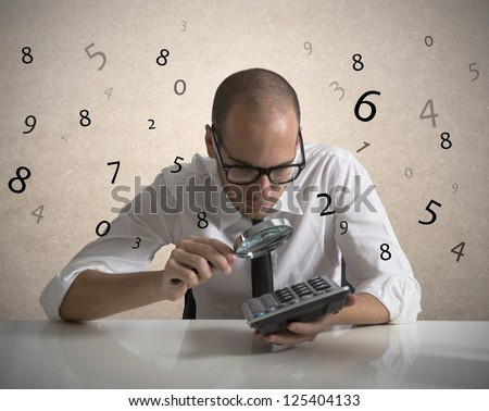 Concept of a businessman that checks the numbers and earnings
