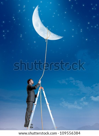 Concept of a businessman that wants the moon