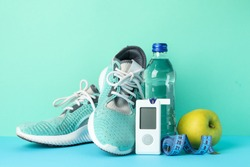 Concept of a healthy diabetic on mint background. Sports diabetic