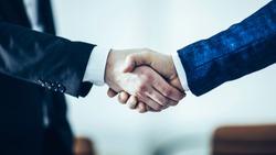 concept of a reliable partnership : a handshake of business par