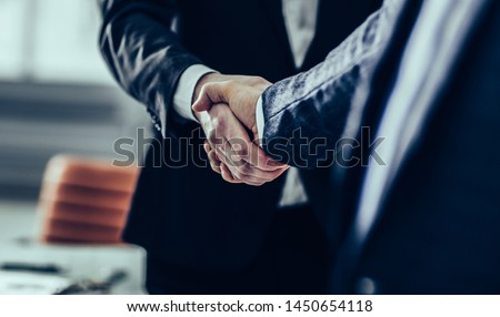 concept of a reliable partnership : a handshake of business part