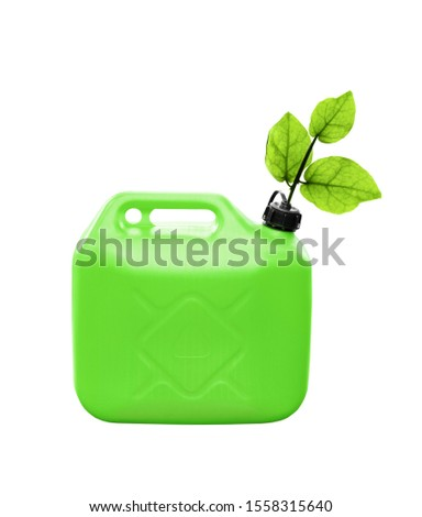 Concept of an ecological fuel. Fresh plant leaves growing from a green plastic jerrycan isolated on white background #1558315640