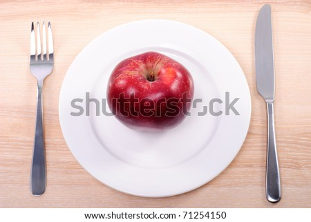 Concept of apple diet with plate on wooden table