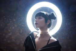concept of artificial life. Beautiful young woman, futuristic style. Portrait against a glowing circle