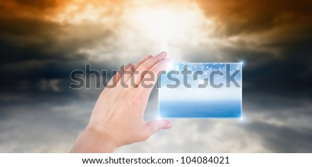 Concept of augmented reality - hand with abstract smartphone, weather forecast #104084021