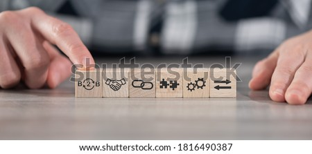 Concept of B2B with icons on wooden cubes Stockfoto ©