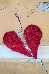 Concept of broken heart on fissure of house wall, as a result of earthquake