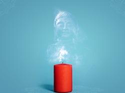 Concept of Buddha Purnima. Red candle with smoke buddha on isolated background.