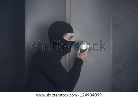 Concept of burglar that open a strongbox