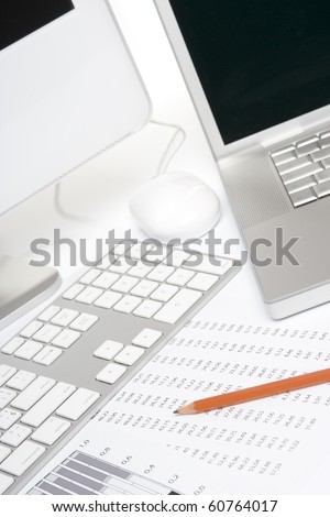 Concept of business analysis - sheet with numbers, graph, pencil and computers