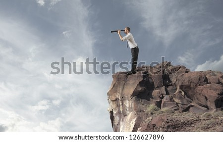 Concept of business exploration with businessman in a mountain