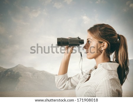 Concept of Business exploration with businesswoman and binoculars