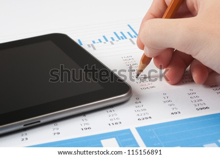 Concept of business report analysis - hand with pencil, digital tablet, graph and sheet. You may place your own screen, for example web page on tablet screen.