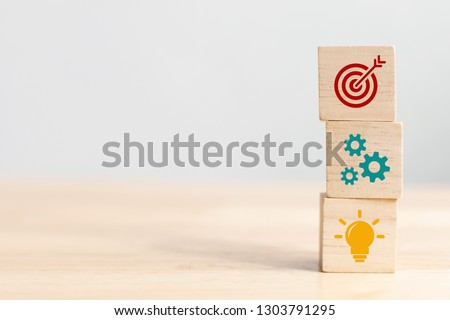 Photo of  Concept of business strategy and action plan. Wood cube block stacking with icon
