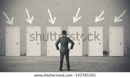 Concept of businessman choosing the right door