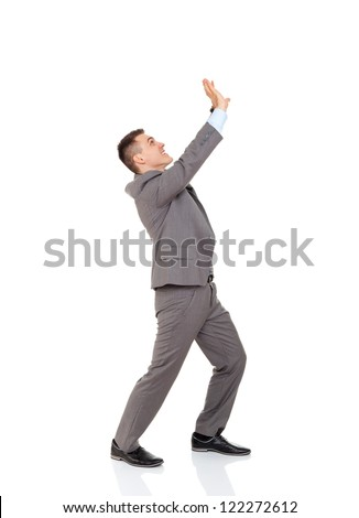 concept of businessman hold something up with hand take upwards empty copy space form above, business man raised arm full length isolated white background