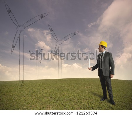 Concept of businessman that plans a wind turbine project