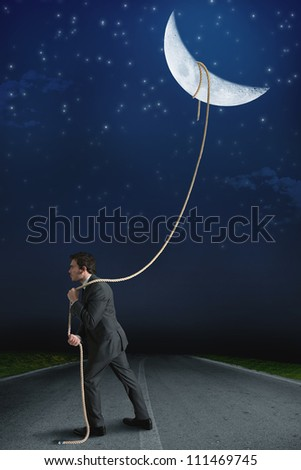 Concept of businessman who obtains the moon with determination