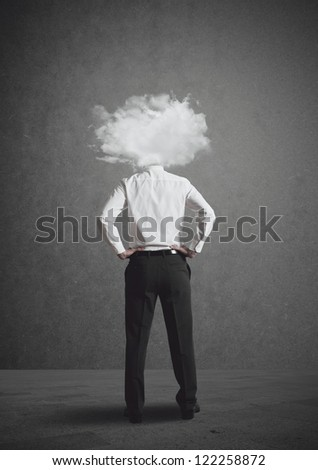 Concept of businessman with head in the clouds