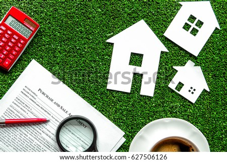 concept of buying house on green background top view